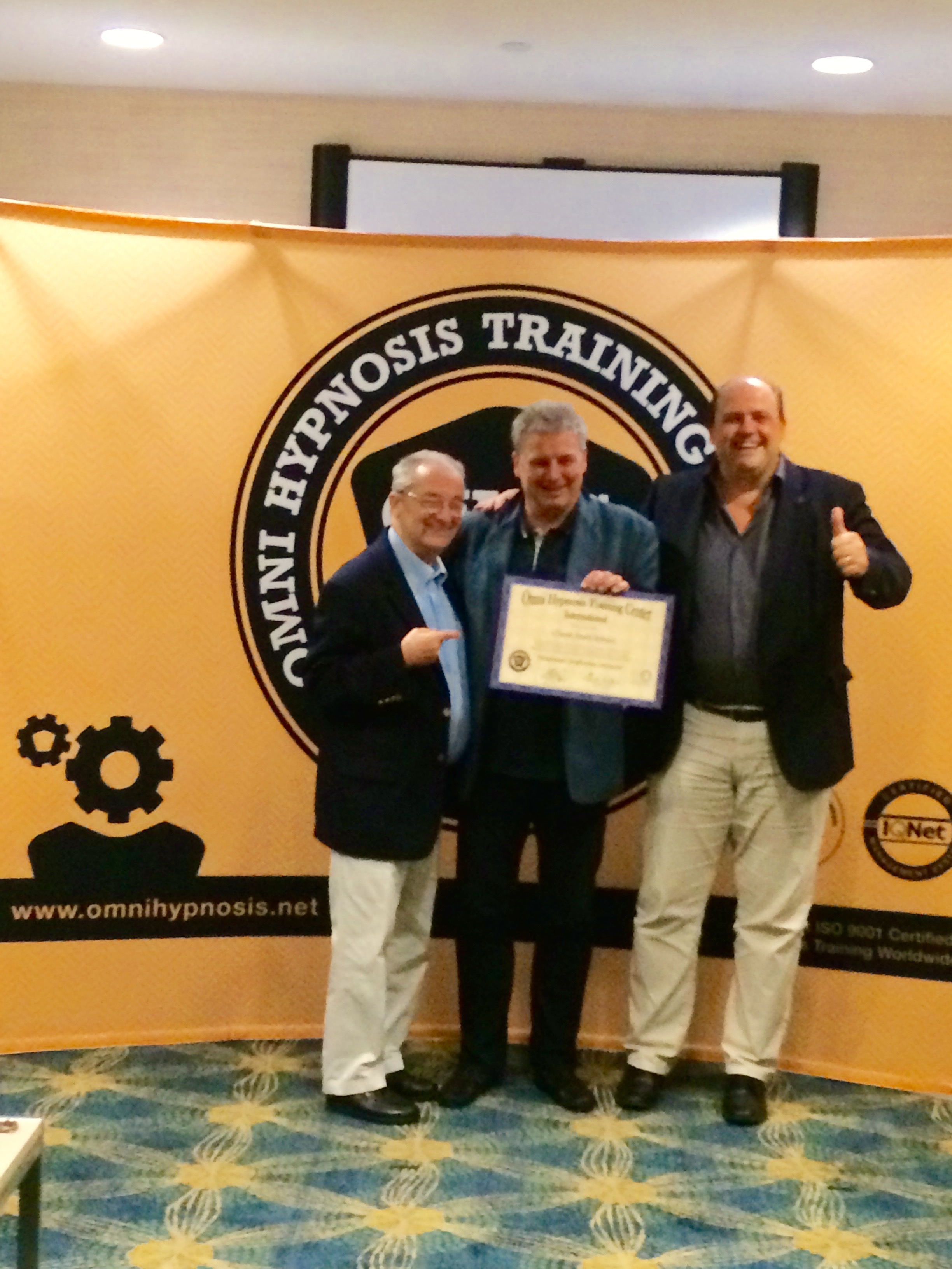 OMNI-Hypnosis Instructor certificate handed over to Claude Ribaux by Gerald Kein and Hansruedi Wipf